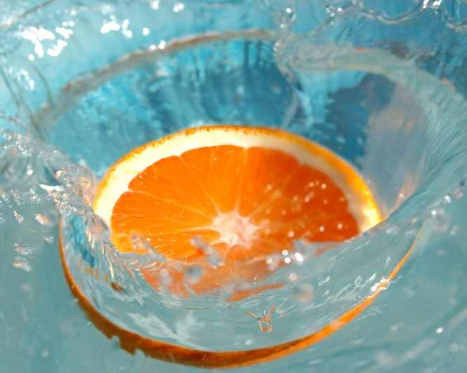 a_slice_orange_on_water